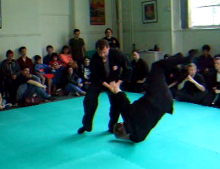 Learning how to throw or knock down your opponent, demonstated